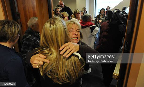 Karen Foster is hugged while leaving a packed Superior Courtroom on June 15 after an Anchorage jury found Kenneth Dion guilty on all counts, of...