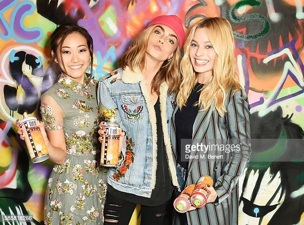 Karen Fukuhara Cara Delevingne Margot Robbie and the cast of 'Suicide Squad' put the finishing touches on Graffiti artist Ryan Meades' mural ahead of...