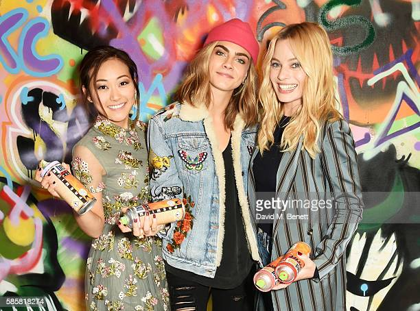 """Karen Fukuhara, Cara Delevingne, Margot Robbie and the cast of """"Suicide Squad"""" put the finishing touches on Graffiti artist Ryan Meades' mural ahead..."""
