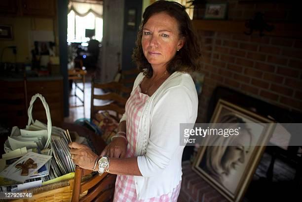 Karen Giddings mother of slain law student Lauren Giddings is photographed in her home with Lauren's dog Butterbean September 14 2011 In the...