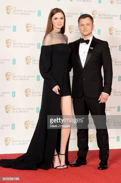Karen Gillan and Taron Egerton pose in the press room during the EE British Academy Film Awards held at Royal Albert Hall on February 18 2018 in...