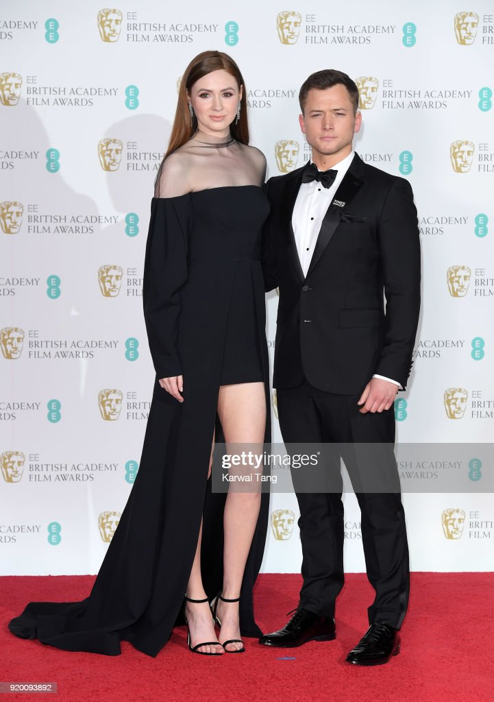 Karen Gillan (L) and Taron Egerton pose in the press room during the EE British Academy Film Awards (BAFTAs) held at the Royal Albert Hall on February 18, 2018 in London, England.