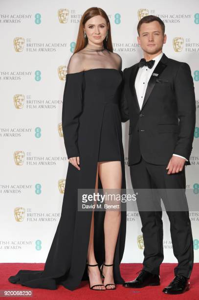 Karen Gillan and Taron Egerton poses in the press room during the EE British Academy Film Awards held at Royal Albert Hall on February 18 2018 in...