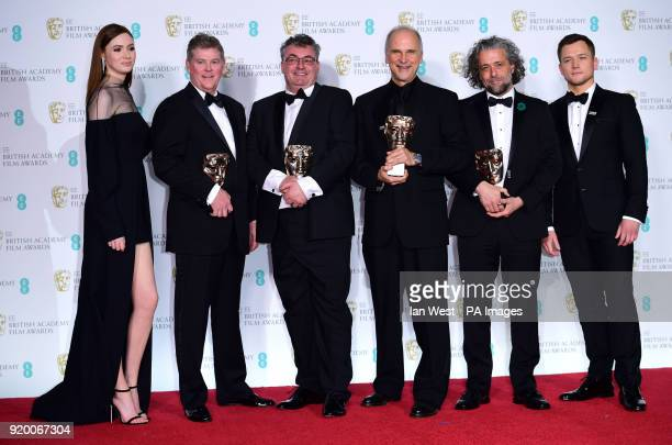 Karen Gillan and Taron Egerton with winners of the BAFTA for Special Visual Effects Richard R Hoover Gerd Nefzer John Nelson and Paul Lambert in the...
