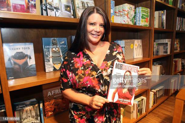 Karen Gravano greets fans and signs copies of her book 'Mob Daughter The Mafia Sammy 'The Bull' Gravano and Me' at Books and Books on April 20 2012...
