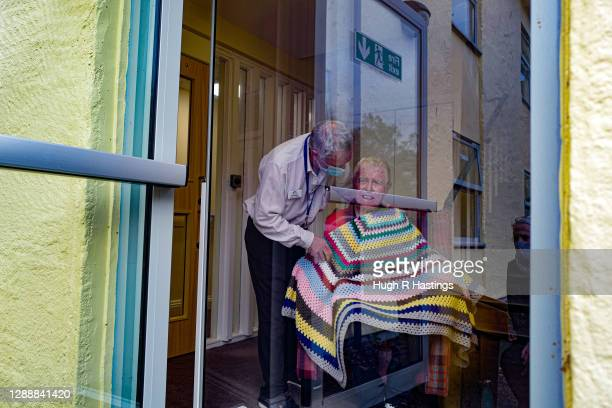 Karen Hastings visits her stepfather Gordon, who suffers from dementia, at the Langholme Care Home on November 28, 2020 in Falmouth, England. Many...
