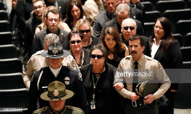 Karen Helus wife of Ventura County Sheriff Sgt Ron Helus holds arms with Ventura County Sheriff Bill Ayub right as they follow the casket of Sgt...