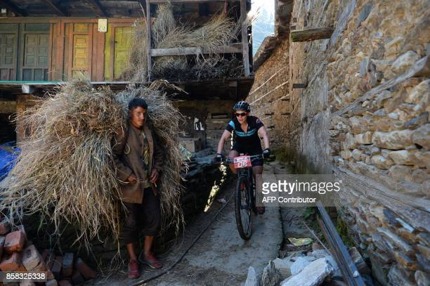 Karen Hill of Australia competes in the 13th edition of the Hero MTB Himalaya mountain bike race in Kangra district in the northern Indian state of...