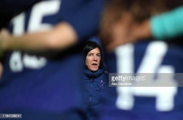 Karen Hills manager of Tottenham Hotspur talks during a team huddle following defeat in the Barclays FA Women's Super League match between Reading...