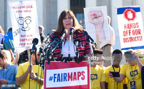 Karen Hobert Flynn president of Common Cause speaks during a rally to call for 'An End to Partisan Gerrymandering' at the Supreme Court of the United...
