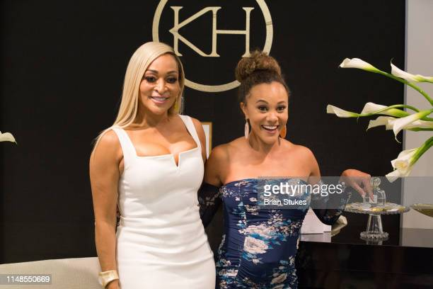 Karen Huger and Ashley Boalch Darby attend La'Dame Fragrance Popup at Bloomingdales on May 11 2019 in Tysons Corner Virginia