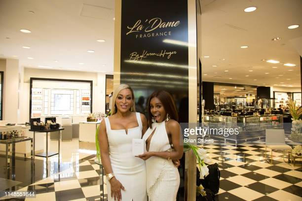 Karen Huger and Candiace Dillard Bassett attend La'Dame Fragrance Popup at Bloomingdales on May 11 2019 in Tysons Corner Virginia