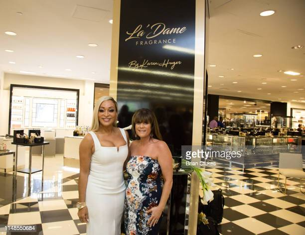 Karen Huger and Robin Barron attend La'Dame Fragrance Popup at Bloomingdales on May 11 2019 in Tysons Corner Virginia
