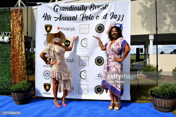 Karen Huger of Housewives of Potomac and Susan Smallwood, producer of Grandiosity Events Cigars & Guitars Charity Polo & Jazz charity event, appear...