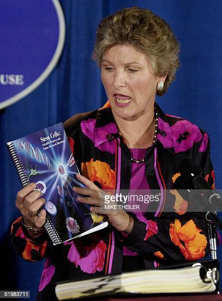Karen Hughes counselor to US President George W Bush holds the White House briefing book on stem cell research at a press briefing 10 August 2001 in...