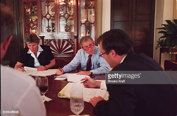 Karen Hughes George W Bush Michael Gerson and Karl Rove review a draft of Bush's Republican National Convention speech at the Governor's Mansion in...