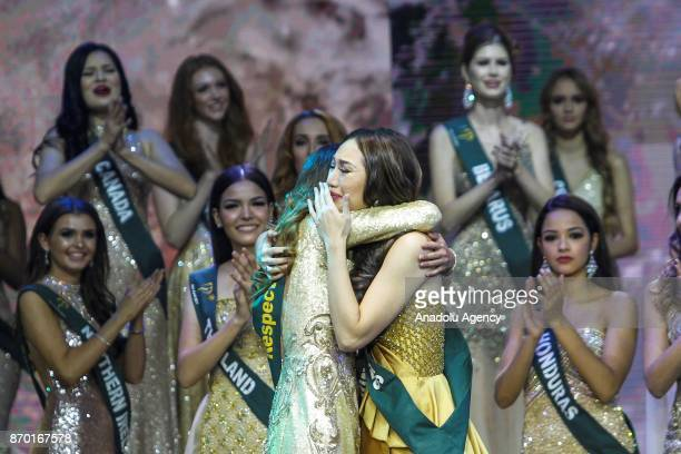 Karen Ibasco hugs Juliana Franco from Colombia as she reacts after announcing her the new Miss Earth 2017 during the coronation night at the Mall of...