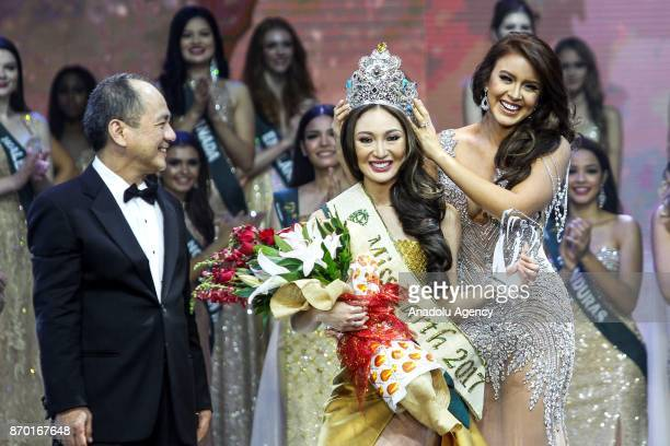 Karen Ibasco is crowned as the new Miss Earth 2017 by MIss Earth 2016 Katherine Espin during the coronation night at the Mall of Asia Arena in Pasay...