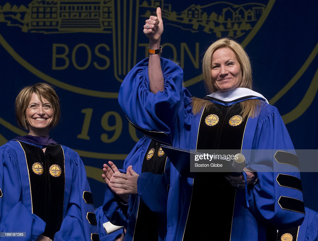 Karen Kaplan, CEO of Hill Holliday, gives the thumbs up after receiving an honorary degree from Deborah Marson of the board of trustees during Suffolk University's commencement ceremony at the Bank of America Pavilion on Sunday, May 19, 2013.