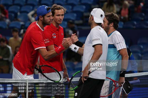 Karen Khachanov and Daniil Medvedev of Team Russia shake hands with Simone Bolelli and Paolo Lorenzi of Team Italy after winning the doubles match...