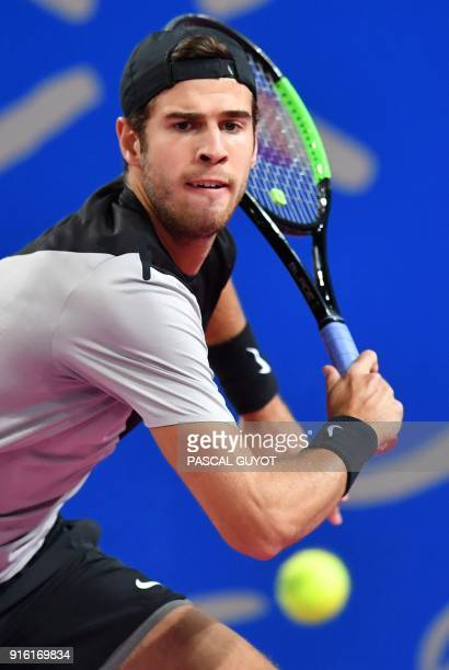 Karen Khachanov from Russia returns the ball to David Goffin from Belgium during their tennis match at the Open Sud de France ATP World Tour in...