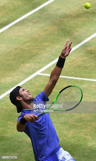 Karen Khachanov from Russia serves the ball to Andrey Rublev from Russia during the ATP tournament tennis in Halle, western Germany, on June 23,...