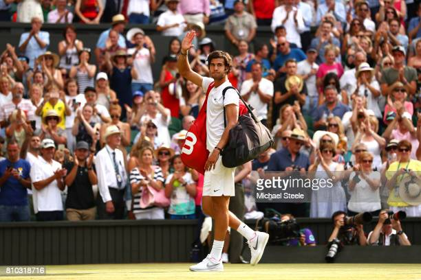 Karen Khachanov of Russia acknowledges the crowd after the Gentlemen's Singles third round match against Rafael Nadal of Spain on day five of the...