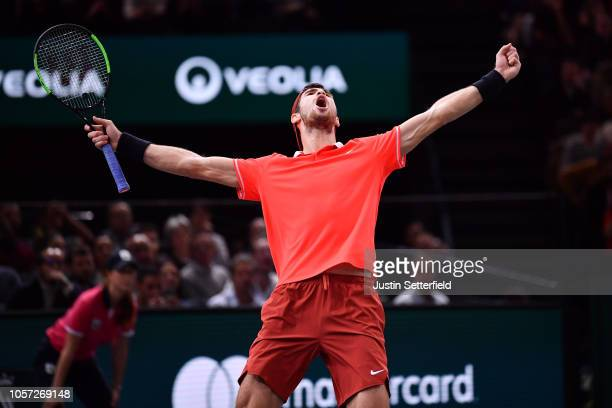 Karen Khachanov of Russia celebrates after winning match point against Novak Djokovic of Serbia during the Men's Final during Day Seven of the Rolex...