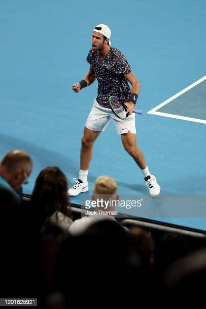 Karen Khachanov of Russia celebrates after winning set point during his Men's Singles third round match against Nick Kyrgios of Australia on day six...
