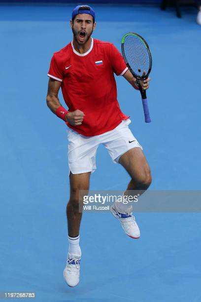 Karen Khachanov of Russia celebrates winning a set against Stefano Travaglia of Italy during day one of the 2020 ATP Cup Group Stage at RAC Arena on...