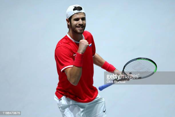 Karen Khachanov of Russia celebrates winning match point against Borna Coric of Croatia during Day 1 of the 2019 Davis Cup at La Caja Magica on...