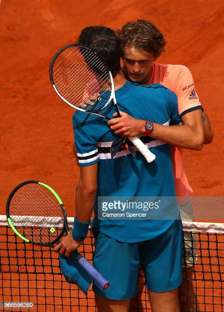 Karen Khachanov of Russia congratulates Alexander Zverev of Germany on victory following their mens singles fourth round match during day eight of...