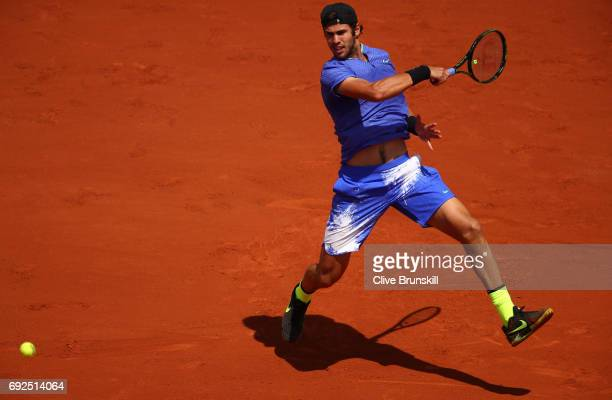 Karen Khachanov of Russia hits a forehand during the men's singles fourth round match against Andy Murray of Great Britain on day nine of the 2017...