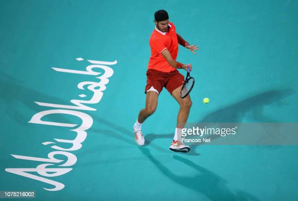 Karen Khachanov of Russia in action against Dominic Thiem of Austria during his men's singles match on day one of the Mubadala World Tennis...