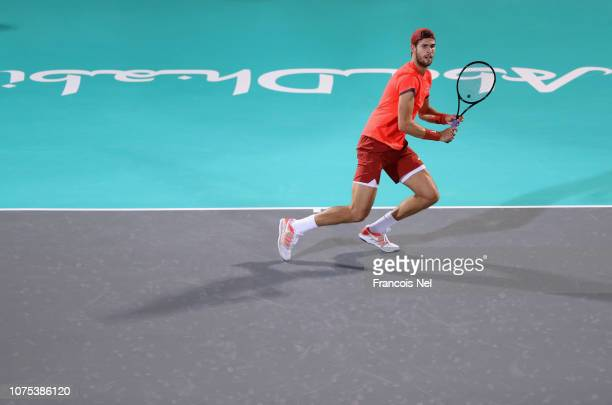 Karen Khachanov of Russia in action against Novak Djokovic of Serbia during his men's singles match on day two of the Mubadala World Tennis...