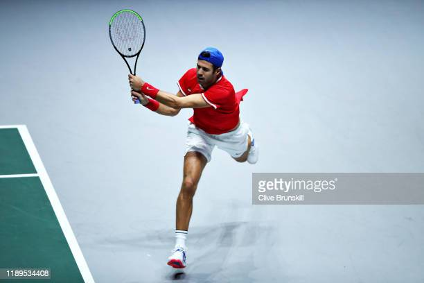 Karen Khachanov of Russia plays a backhand in his semi final singles match against Denis Shapovalov of Canada during Day Six of the 2019 Davis Cup at...
