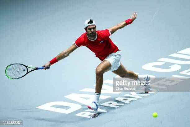 Karen Khachanov of Russia plays a forehand against Novak Djokovic of Serbia during his quarter final singles match on Day Five of the 2019 David Cup...