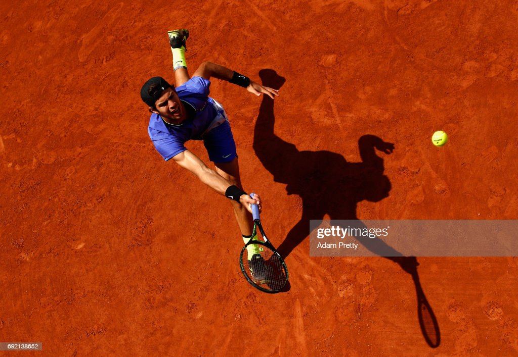 Karen Khachanov of Russia plays a forehand during the mens singles first round match against John Isner of The United States on day eight of the 2017 French Open at Roland Garros on June 4, 2017 in Paris, France.