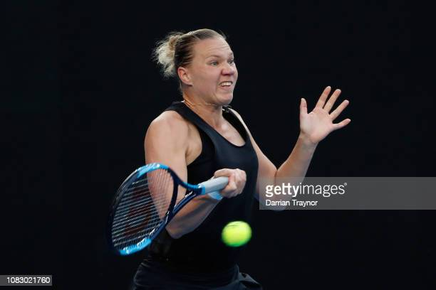 Karen Khachanov of Russia plays a forehand in her first round match against Simona Halep of Romania during day two of the 2019 Australian Open at...