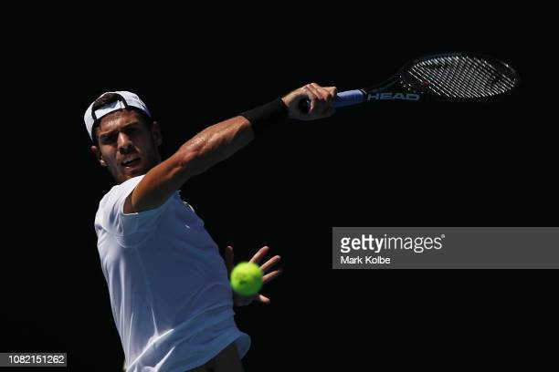 Karen Khachanov of Russia plays a forehand in his first round match against Peter Gojowczyk of Germany during day one of the 2019 Australian Open at...