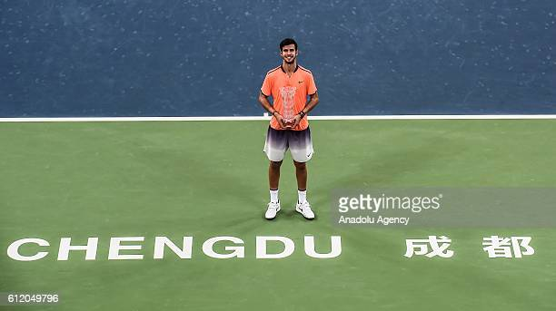 Karen Khachanov of Russia poses for a photo with his trophy after he win the game of the Men's final of ATP Chengdu Open in Chengdu, China on October...
