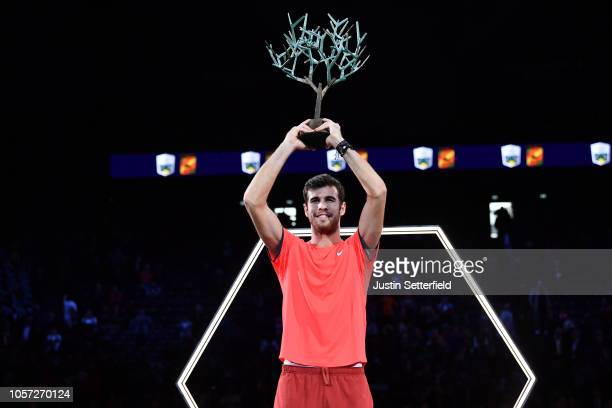 Karen Khachanov of Russia poses with the trophy after he wins the match against Novak Djokovic of Serbia during the Men's Final during Day Seven of...