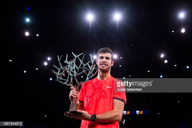 Karen Khachanov of Russia poses with the trophy after winning the Rolex Paris Masters Final against Novak Djokovic of Serbia during Day 7 of the...