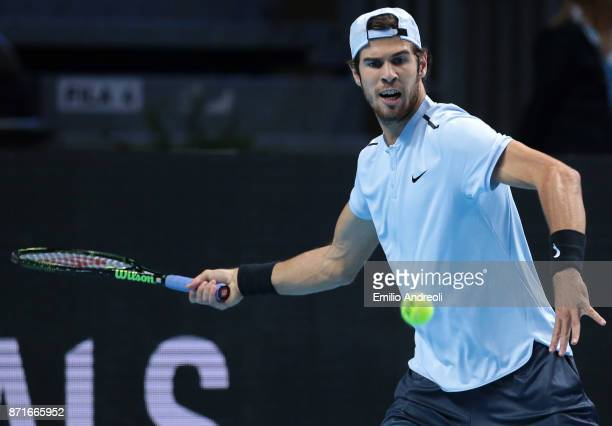 Karen Khachanov of Russia returns a forehand in his match against Jared Donaldson of the United States during Day 2 of the Next Gen ATP Finals on...