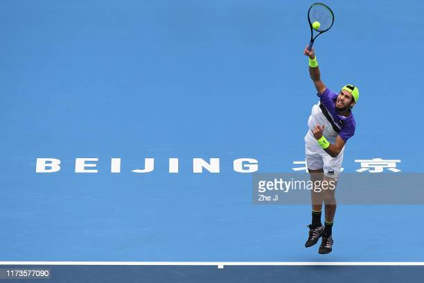 Karen Khachanov of Russia returns a shot in his Men's singles Quarter Final against Fabio Fognini of Italy during the 2019 China Open at the China...