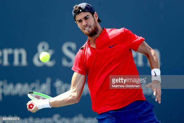 Karen Khachanov of Russia returns a shot to Yuichi Sugita of Japan during day 6 of the Western Southern Open at the Lindner Family Tennis Center on...
