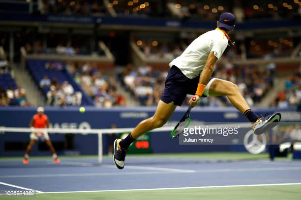 Karen Khachanov of Russia returns the ball through his legs during his men's singles third round match against Rafael Nadal of Spain on Day Five of...