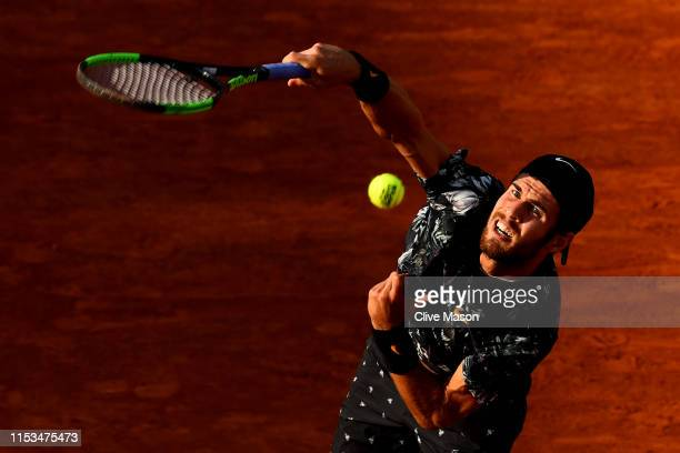 Karen Khachanov of Russia serves during his mens singles fourth round match against Juan Martin Del Potro of Argentina during Day nine of the 2019...