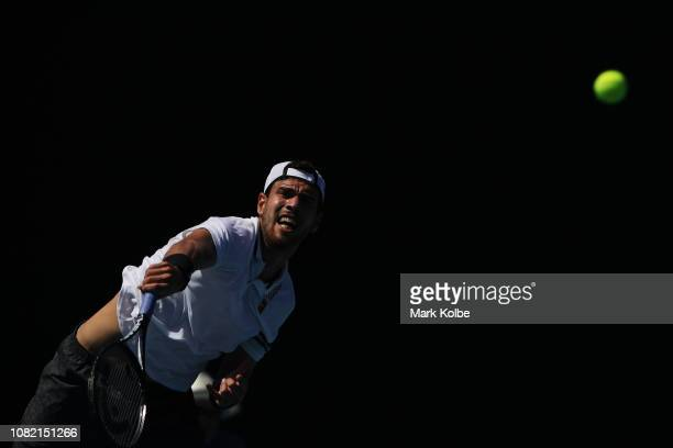 Karen Khachanov of Russia serves in his first round match against Peter Gojowczyk of Germany during day one of the 2019 Australian Open at Melbourne...
