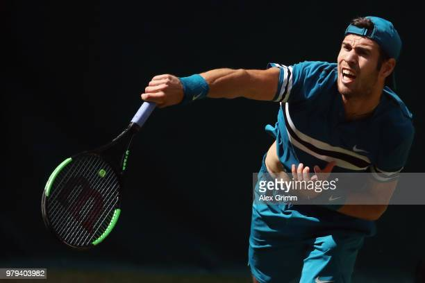 Karen Khachanov of Russia serves the ball to Kei Nishikori of Japan during their round of 16 match on day 3 of the Gerry Weber Open at Gerry Weber...